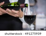 mid section of bartender... | Shutterstock . vector #491275939
