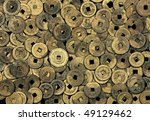 Antique cast bronze Chinese coins from the late 19th and early 20th centuries. - stock photo