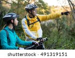 biker couple with mountain bike ... | Shutterstock . vector #491319151