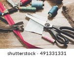 scissors  bobbins with thread... | Shutterstock . vector #491331331