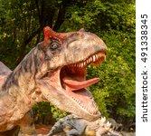 Small photo of BRATISLAVA, SLOVAKIA - SEP 28, 2016: Allosaurus in DinoPark in Bratislava, Slovakia. Allosaurus is a genus of large theropod dinosaur