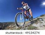 Person Riding A Bike Downhill...