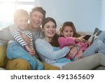 family watching television... | Shutterstock . vector #491365609