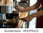 waiter using a tamper to press... | Shutterstock . vector #491370121