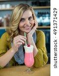 portrait of woman drinking... | Shutterstock . vector #491371429