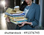 businesswoman carrying stack of ... | Shutterstock . vector #491376745