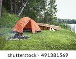 an orange tent  a campfire and... | Shutterstock . vector #491381569