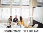 photo editors using laptop in... | Shutterstock . vector #491401165
