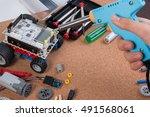 hand holding soldering iron... | Shutterstock . vector #491568061