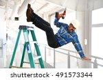 hispanic worker falling from... | Shutterstock . vector #491573344