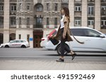 young beautiful woman in beige... | Shutterstock . vector #491592469