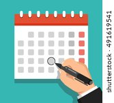 calendar on the wall and hand... | Shutterstock .eps vector #491619541