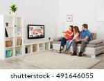 family watching tv | Shutterstock . vector #491646055