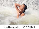 young beautiful woman bathes in ... | Shutterstock . vector #491673091