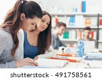 girls studying together in the... | Shutterstock . vector #491758561