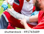medical worker treating burns... | Shutterstock . vector #491765689