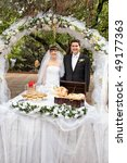 smiling bride and groom near...   Shutterstock . vector #49177363