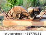 Small photo of Lumberjack, logger, saw cutting wood.