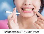 Woman Holding Cigarettes With...