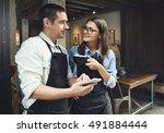 couple barista coffee shop... | Shutterstock . vector #491884444