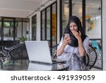 muslim girl working on laptop... | Shutterstock . vector #491939059