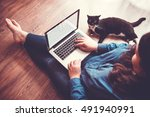 Stock photo beautiful plus size girl works on her laptop on the floor toned picture 491940991