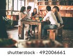 enjoying dinner with friends.... | Shutterstock . vector #492006661