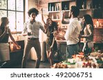 friends dancing. cheerful young ... | Shutterstock . vector #492006751