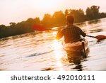 Enjoying Sunset On River. Rear...
