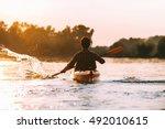 man kayaking. rear view of... | Shutterstock . vector #492010615
