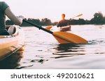 People Kayaking. Rear View...