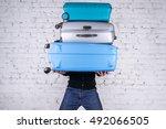 man holding three heavy... | Shutterstock . vector #492066505