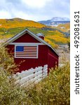 Red Barn With American Flag...