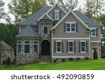 new large suburban house | Shutterstock . vector #492090859