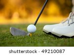 Golf player hitting the ball close-up on shoes - stock photo