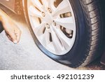 Small photo of Technician is repairing car flat tire