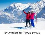 happy mature couple skiing in... | Shutterstock . vector #492119431