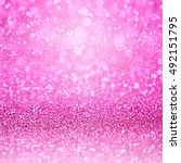 Small photo of Pink glitter confetti sparkle girly background or girl princess happy birthday party invitation