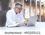 skilled man programmer develops ... | Shutterstock . vector #492205111