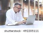 skilled man programmer develops ... | Shutterstock . vector #492205111