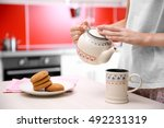 Woman Giving Some Tea In Kitchen