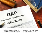 Small photo of GAP insurance form on a table with a book.