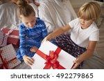 kids opening big christmas gift ... | Shutterstock . vector #492279865