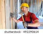 carpenter using hammer in a... | Shutterstock . vector #492290614