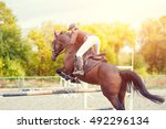 Stock photo equestrian sport background young sportswoman taking her course on show jumping competition 492296134