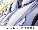 a row of new cars parked at a... | Shutterstock . vector #492342121