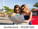 group of friends on a roadtrip... | Shutterstock . vector #492387184