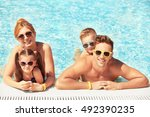 happy family in swimming pool... | Shutterstock . vector #492390235