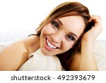 woman sitting on the bed... | Shutterstock . vector #492393679