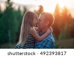 father and daughter kissing at... | Shutterstock . vector #492393817